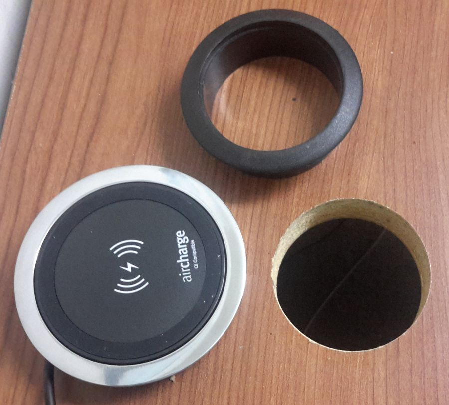 This grommet hole is too small for the Wireless Surface Charger.