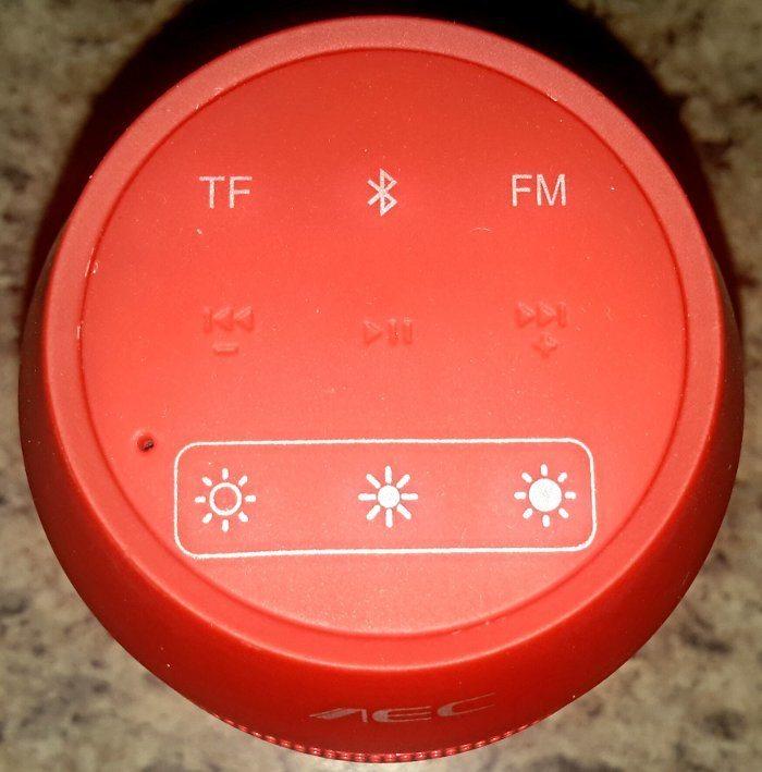Andoer Bluetooth speaker push navigation buttons.