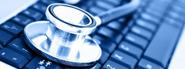 Close-up of stethoscope on laptop keyboard