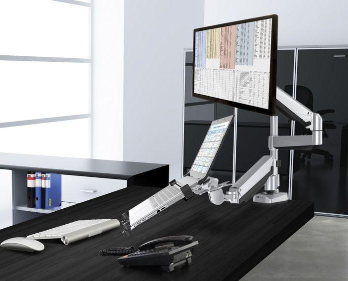 Loctek Dual Arm Desk Mount monitor high and laptop low.