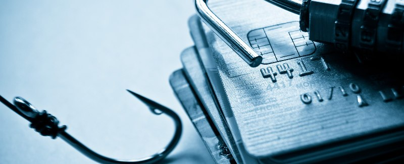security-lock-on-credit-cards-with-a-fish-hook-note-shallow-depth-of-field