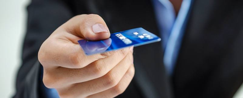 bank-office-worker-providing-credit-card