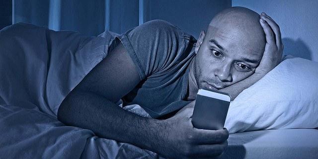 blue-light-phone-at-night