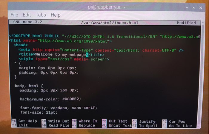 You can edit the default HTML page in Raspbian's Nano text editor.