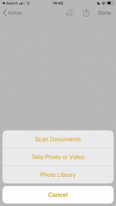 Scanning a document with the Apple Notes application.