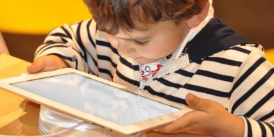 A child using a smart tablet device.