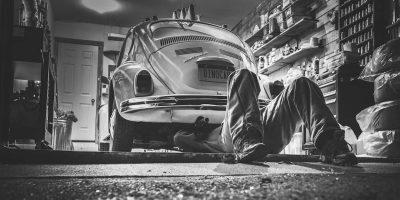 A mechanic working on a car.