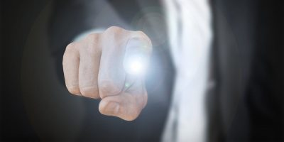 A man with energy coming out of his finger.
