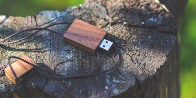 Wooden pen drives on a log.